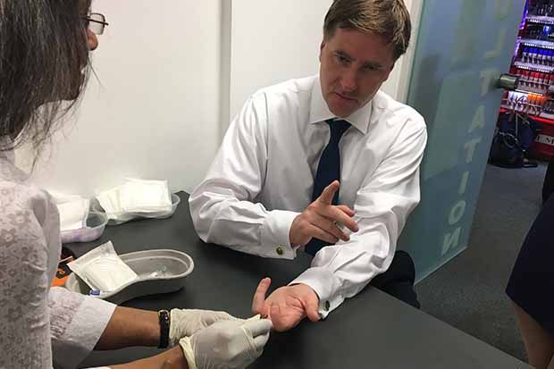 Former pharmacy minister Steve Brine having a mock blood test for hepatitis C in London