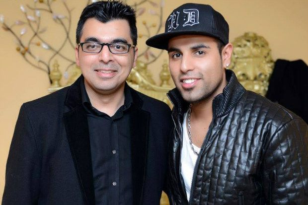 Khalid Ahmed (left), pictured with musician H-Dhami, uses the same skills in pharmacy and music