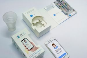 The at-home testing kit is paired with an app, which analyses the patient's urine sample