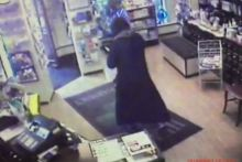 CCTV footage shows the suspect leaving the premises (image credit: Heath Pharmacy)