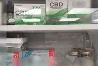 CBD products in a glass-fronted cabinet in Bannside Pharmacy, Northern Ireland